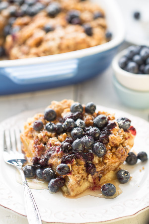Overnight Blueberry Cream Cheese French Toast Bake - An easy and delicious baked French Toast bursting with blueberries and cream cheese. Perfect for breakfast, brunch or even dinner and best of all, so easy to assemble the night before!