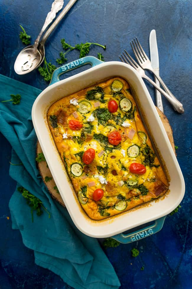 Top view of egg casserole in a casserole dish on a blue background