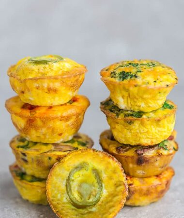 Side view of 9 breakfast muffins on a grey background