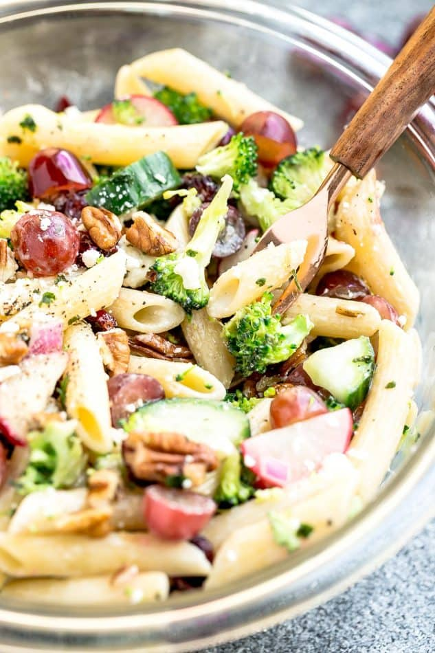 Broccoli Pasta Salad with grapes and pecans in a glass bowl