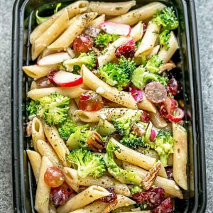 Broccoli Pasta Salad with grapes and pecans in a meal prep container