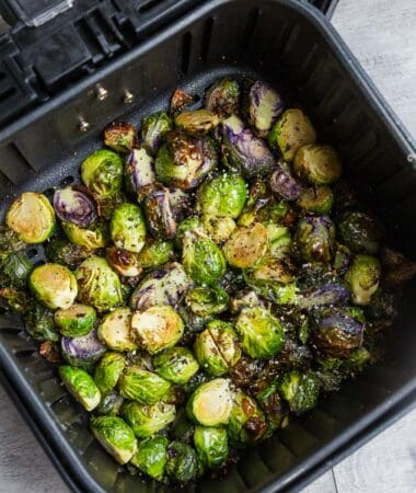 Top view of air fried Brussels sprouts in an air fryer basket