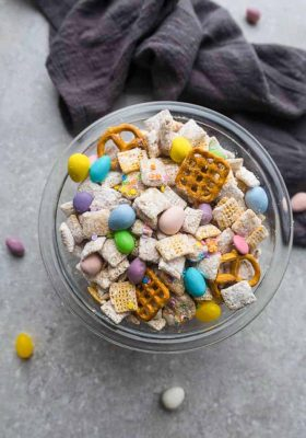 Bunny Bait – the perfect easy sweet and salty snack to munch on for spring or Easter parties. Best of all, this simple mix is fun to make with Rice Chex cereal, peanut butter, pretzels, festive Easter egg candies and confetti sprinkles.