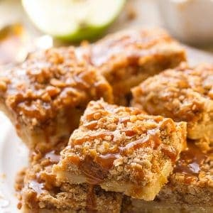 Caramel Apple Pie Bars stacked on a plate