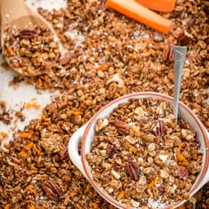 Top view of baking sheet with healthy carrot cake granola