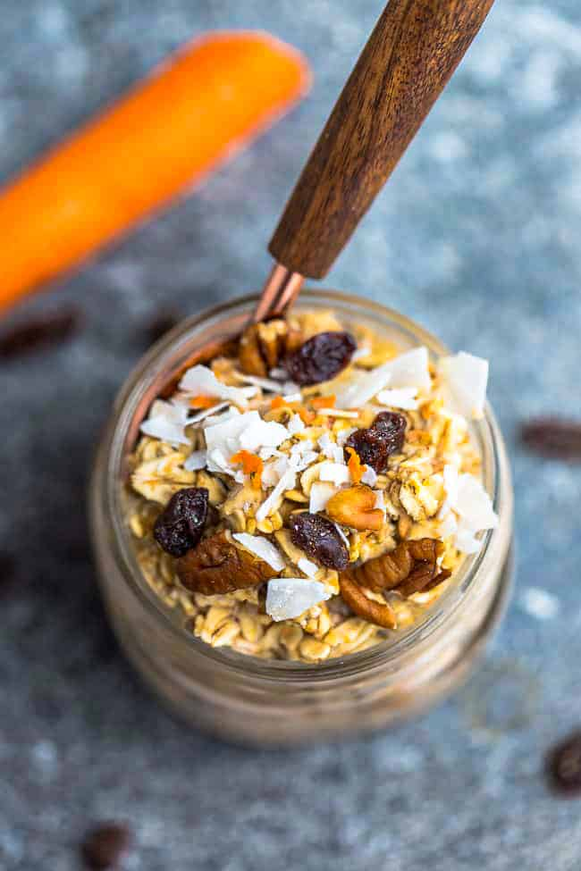 Top view of carrot cake overnight oats in a jar with a spoon