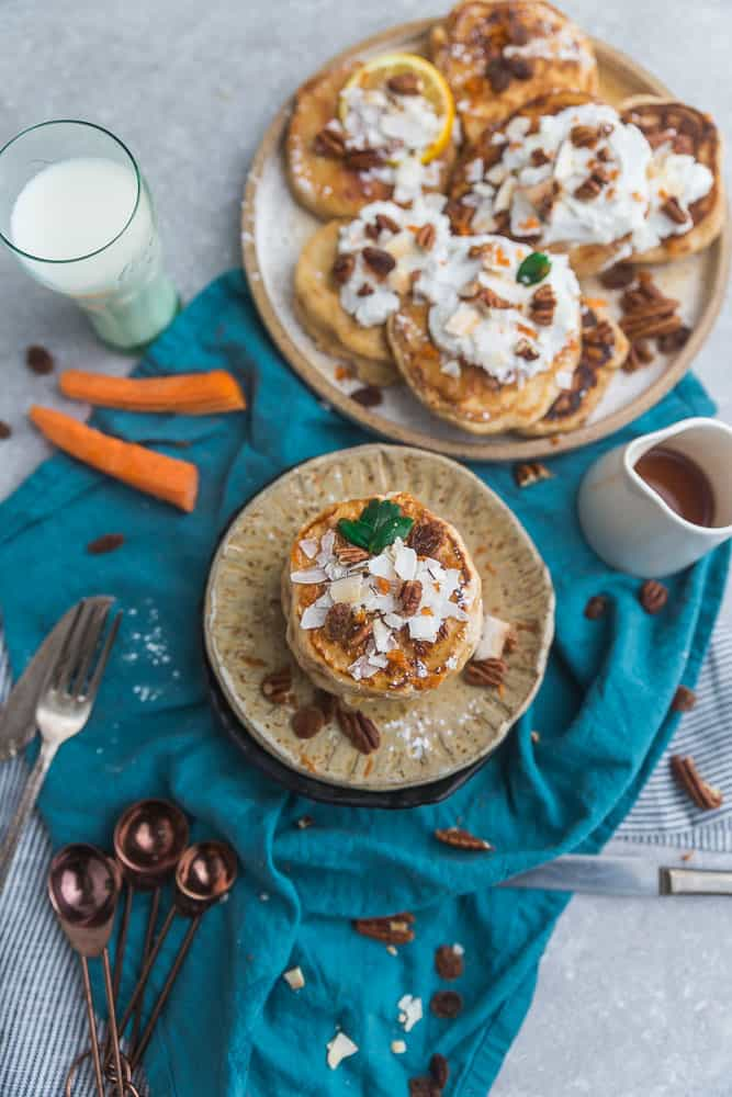 These Carrot Cake Pancakes perfect or any spring breakfast or Easter brunch. Best of all, they're low carb and have all the classic flavors you love about the popular cake. It's like having dessert for breakfast Keto-friendly ingredients. Grain free, sugar free and made with coconut, carrots, pecans and cream cheese.