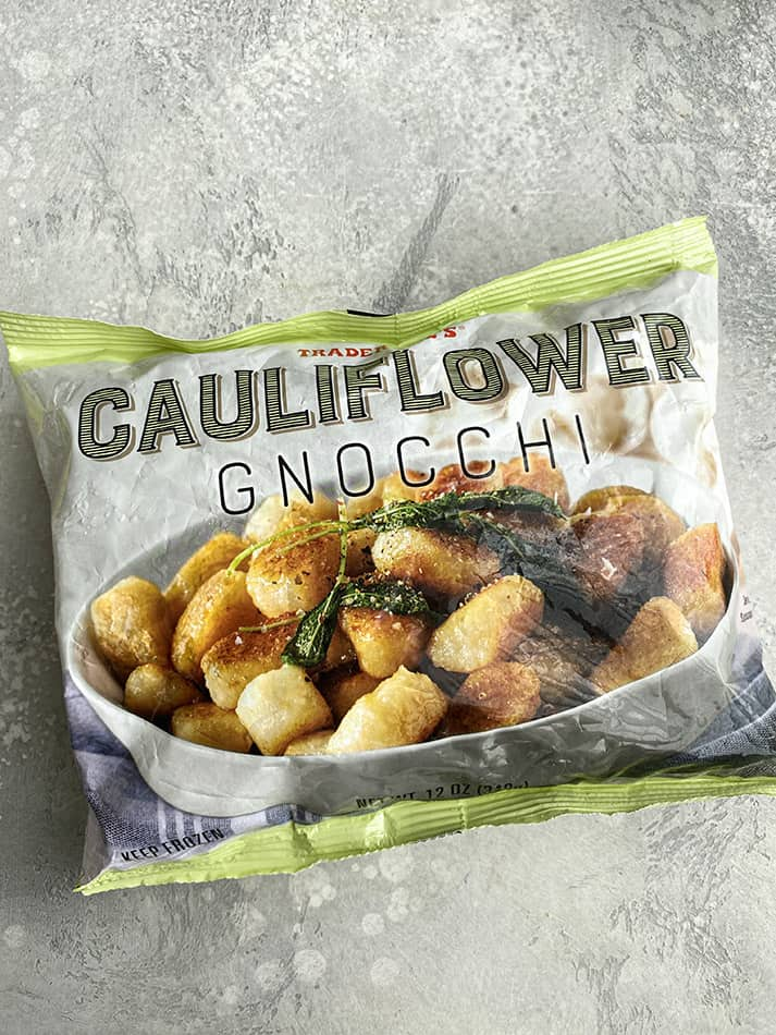 A package of Trader Joe's Cauliflower Gnocchi on a grey background
