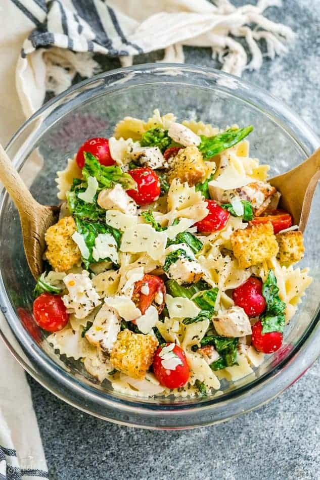 Chicken Caesar Pasta Salad - the perfect side dish to bring to summer potlucks, parties, Memorial Day / Fourth of July grillouts/barbecues. Best of all, it's so easy to make and has all the classic flavors of a caesar salad. Perfect for Sunday meal prep and leftovers are delicious for school or work lunchboxes or lunchbowls.