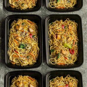 Top view of six meal prep containers of Chicken Chow Mein
