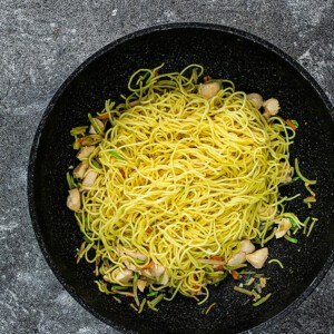 Top view of chow mein noodles in a wok