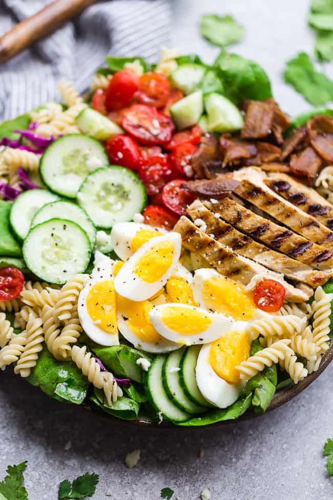 Cobb Pasta Salad - an easy side dish perfect for summer parties, picnics, potlucks and BBQ's. Made with bacon, avocado, grilled chicken, tomatoes, hard-boiled eggs, cheese, and a homemade ranch dressing.