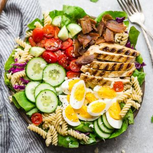 Cobb Pasta Salad - an easy side dish perfect for summer parties, picnics, potlucks and BBQ's. Made with bacon, cucumbers, grilled chicken, tomatoes, hard-boiled eggs, cheese, and a homemade ranch dressing.