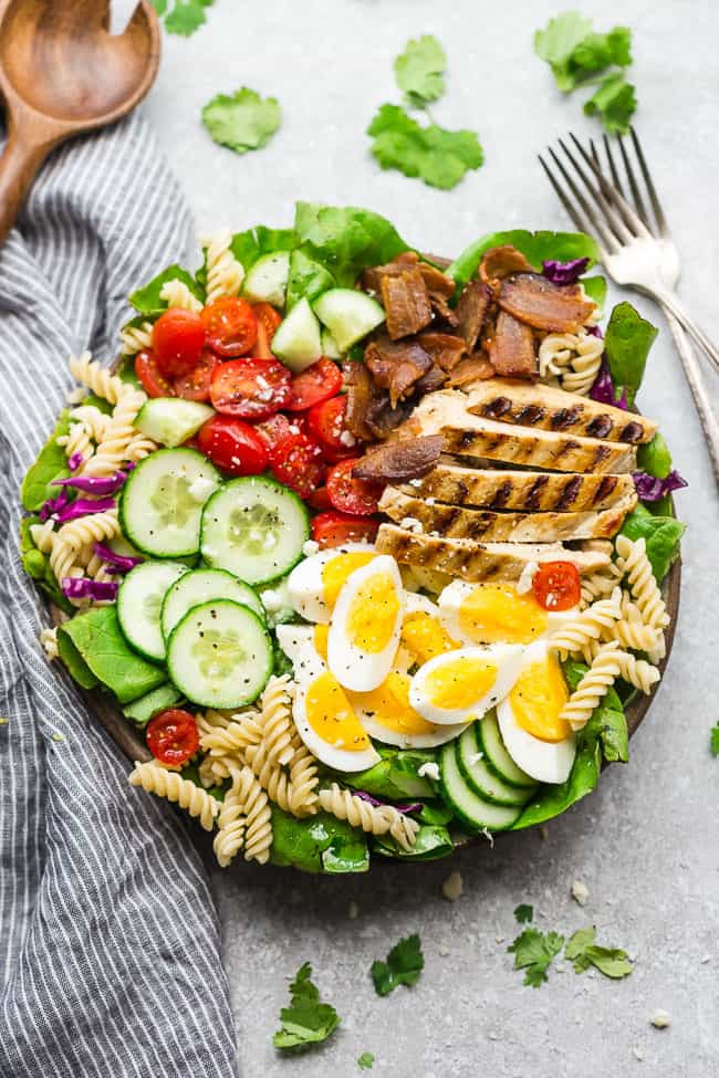 Cobb Pasta Salad - an easy side dish perfect for summer parties, picnics, potlucks and BBQ's. Made with with bacon, avocado, grilled chicken, tomatoes, hard-boiled eggs, cheese, and homemade dressing.