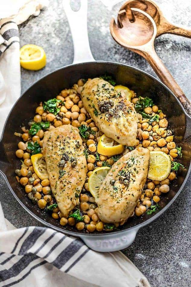 This recipe for Chicken Piccata with Chickpeas is the perfect easy protein-packed meal for busy weeknights or impressive enought for date night. Best of all, comes together in just 30 minutes with a tangy lemon sauce with capers. Great for Sunday meal prep for packing into school or work lunchboxes or lunch bowls.