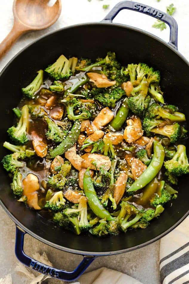 Chicken Stir Fry with Broccoli Snap Peas is the perfect easy weeknight meal. Best of all, comes together in under 30 minutes with your favorite vegetables and sticky and savory Asian sauce. Great for Sunday meal prep for work or school lunchboxes or lunch bowls. Full of flavor and way better than takeout!
