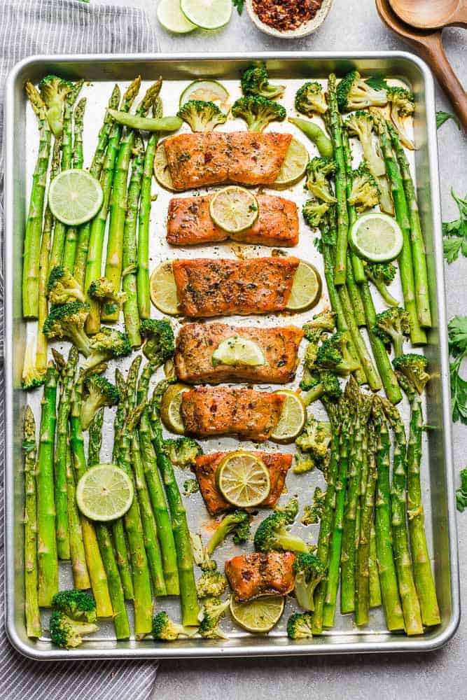 This Chili Lime Salmon with asparagus and broccoli is baked to tender, flaky perfection. Best of all, it's fresh, flavorful and super delicious! Comes together in less than 30 minutes and is just perfect for busy weeknights! Made with a sweet and tangy honey, lemon and parsley and the perfect spring or summer meal! Line baking sheet with parchment paper or foil for easier clean up.