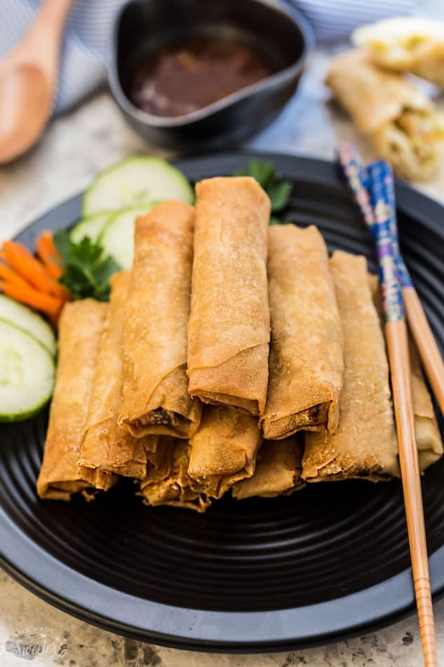 Authentic Chinese Spring Rolls (Egg Rolls) - an authentic passed down family favorite recipe, perfectly golden and makes the perfect appetizer for Chinese (Lunar) New Year, game day or any other party. Best part of all, there are secret family tips, instructions for a baked or fried version. The perfect balance of meat, veggies and comes out crispy, delicious and seriously amazing!!