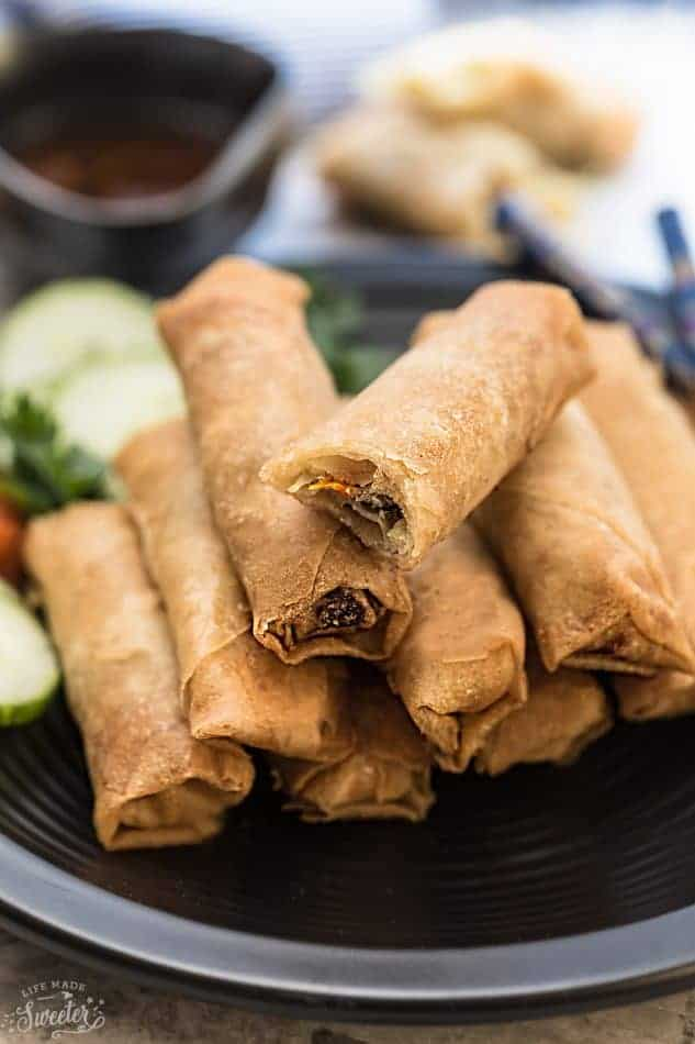 Chinese Spring Rolls (Egg Rolls) - authentic family favorite recipe, perfectly golden and makes the perfect appetizer for Chinese (Lunar) New Year, game day or any other party. Best part of all, there are secret family tips, instructions for a baked or fried version. The perfect balance of meat, veggies and comes out crispy, delicious and seriously amazing!!