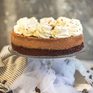 The BEST ever creamy Chocolate Cheesecake that is perfect for the ultimate chocolate lovers. Made with a fudgy brownie bottom and a rich, decadent chocolate cheesecake center, topped with sweet chocolate ganache and whipped cream. A showstopping dessert for Christmas, Easter, Thanksgiving, birthday parties or any holiday gatherings. #cheesecake #chocolate #chocolatecheesecake #ganache #creamy #brownie #whippedcream