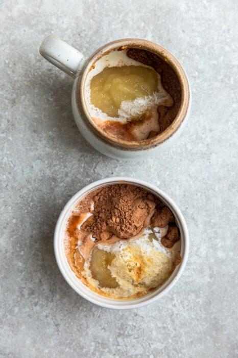 Ingredients for chocolate mug cake in two mugs