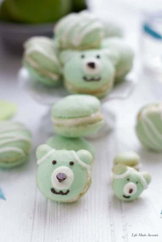 Coconut macarons filled with key lime buttercream & toasted coconut make the perfect tropical inspired treat for summer