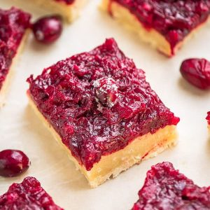 Close-up view of healthy cranberry bars on a white background