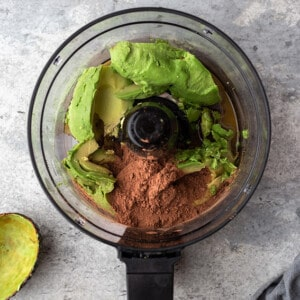 Ingredients for easy chocolate pudding in a food processor bowl