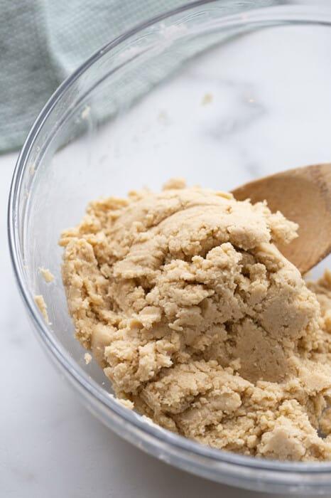 Cinnamon roll dough in a glass bowl