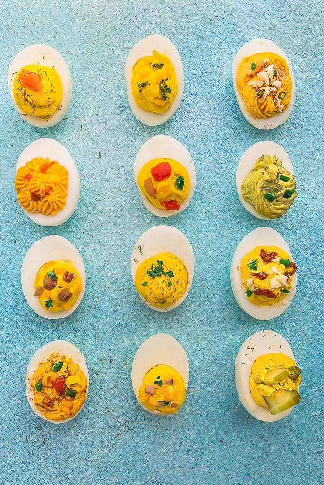 Perfect Deviled Eggs - 12 different ways are the perfect easy make-ahead appetizers for Easter Mother's Day or any weekend or holiday brunch. Best of all, they are low carb, keto and packed with protein. Flavors include: smoked salmon, broccoli & cheese, buffalo chicken, spicy chili, chipotle & salsa, avocado, bacon & cheese, classic deviled egg, sun-dried tomato, southwestern, ham & cheddar & dill pickle