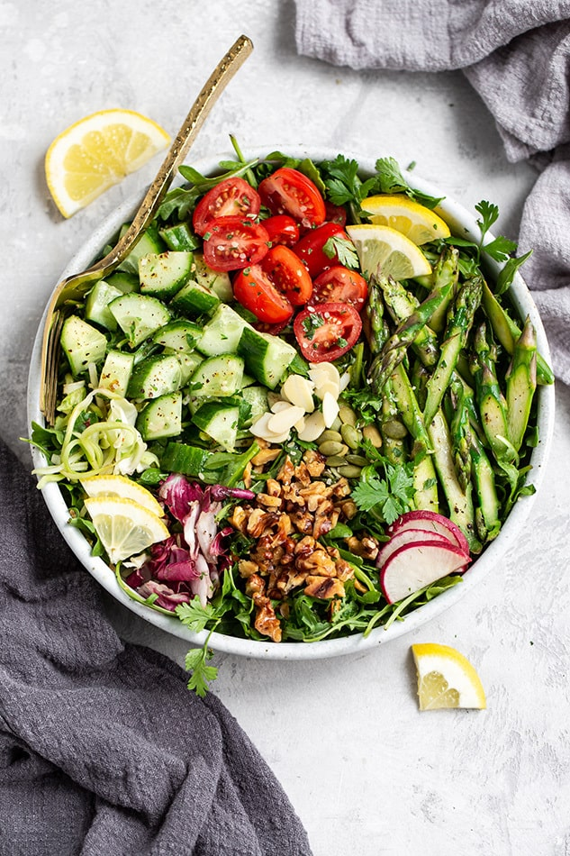 Overhead view of asparagus salad in a bowl with a fork