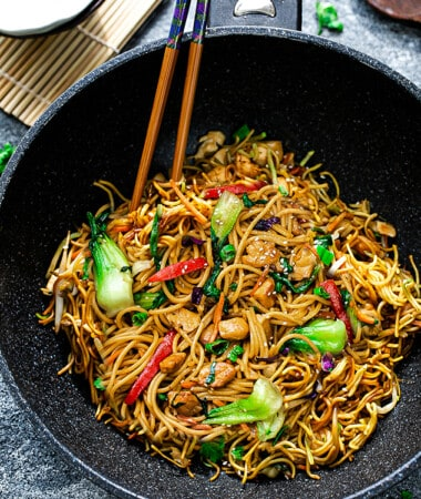 Top view of easy chicken lo mein in a wok with chopsticks