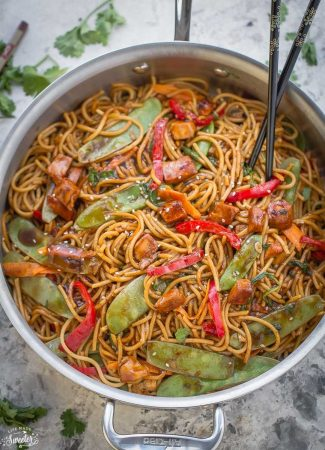 Chicken Lo Mein in a skillet with chopsticks