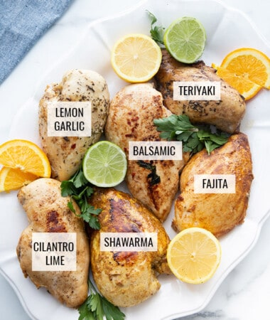 6 cooked chicken breasts on a white plate with labels