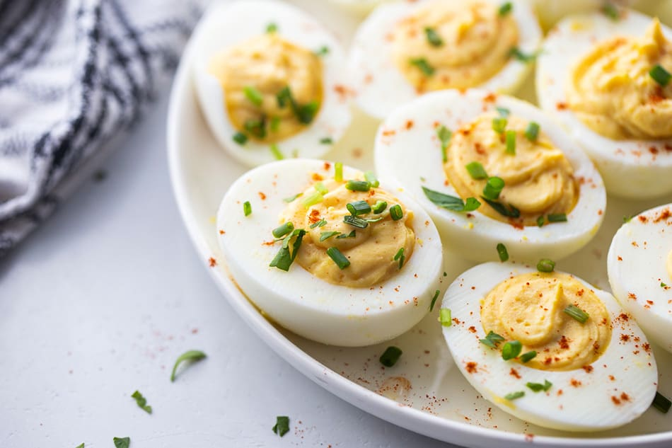 Close-up of deviled eggs on a white plate