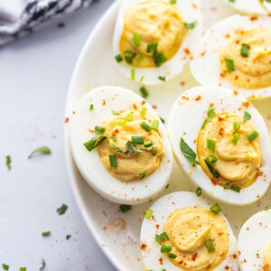 Top view of 5 Deviled eggs on a white plate