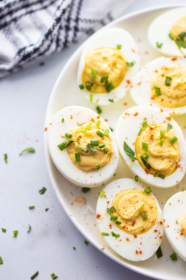 Overhead view of deviled eggs on a white plate