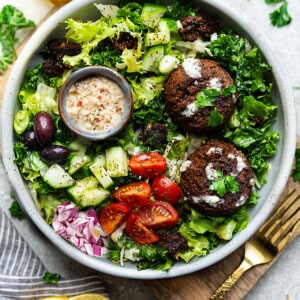 Easy Falafel Salad in a white bowl with a gold fork