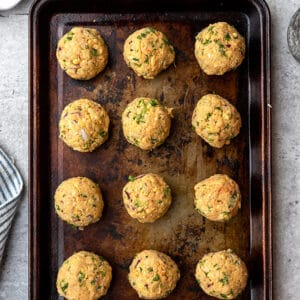 Top view of uncooked falafel balls on a baking pan