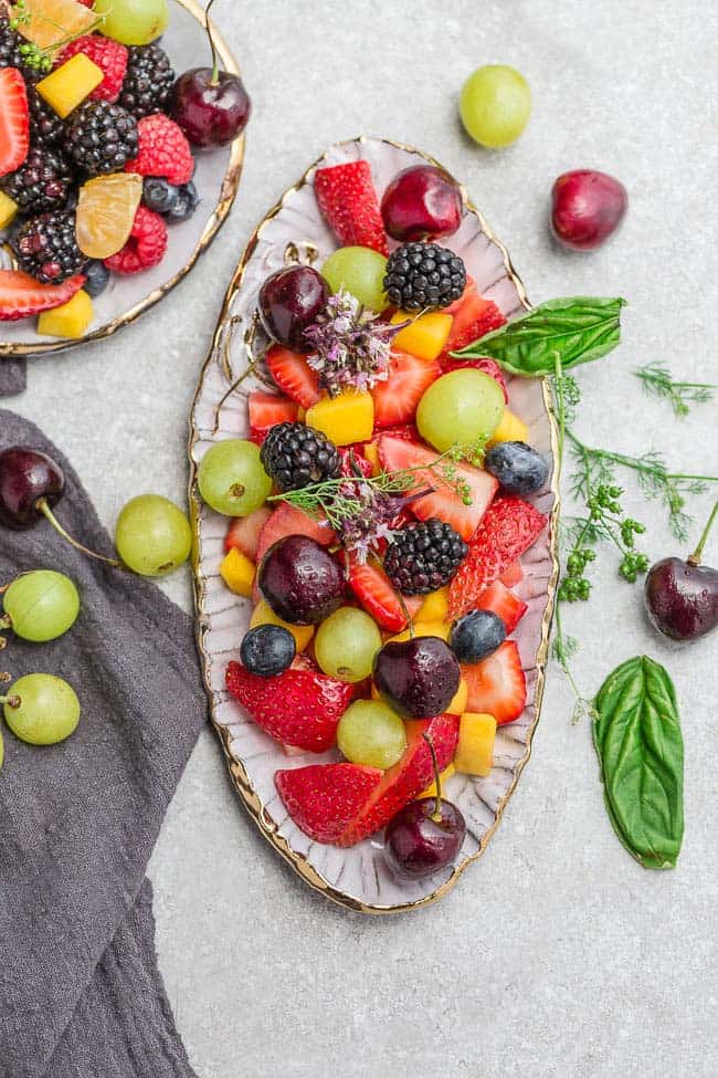 Easy Fruit Salad - a quick and healthy snack, breakfast, side dish or dessert! Made with fresh, seasonal fruit and a simple dressing made with lime juice and honey.