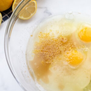 A bowl of eggs and melted coconut oil for the lemon cake batter