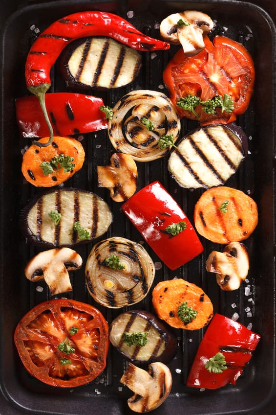 Top view of grilled vegetables on grill.