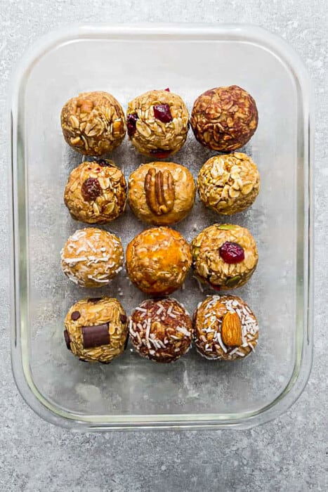 Twelve No-Bake Energy Bites in a Glass Pan on a Countertop