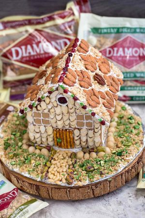 "Easy No Bake Gingerbread House - An easy and simple way to make a ""gingerbread"" house using graham crackers and nuts. It's the perfect holiday activity for the kids and best of all, no baking required!"
