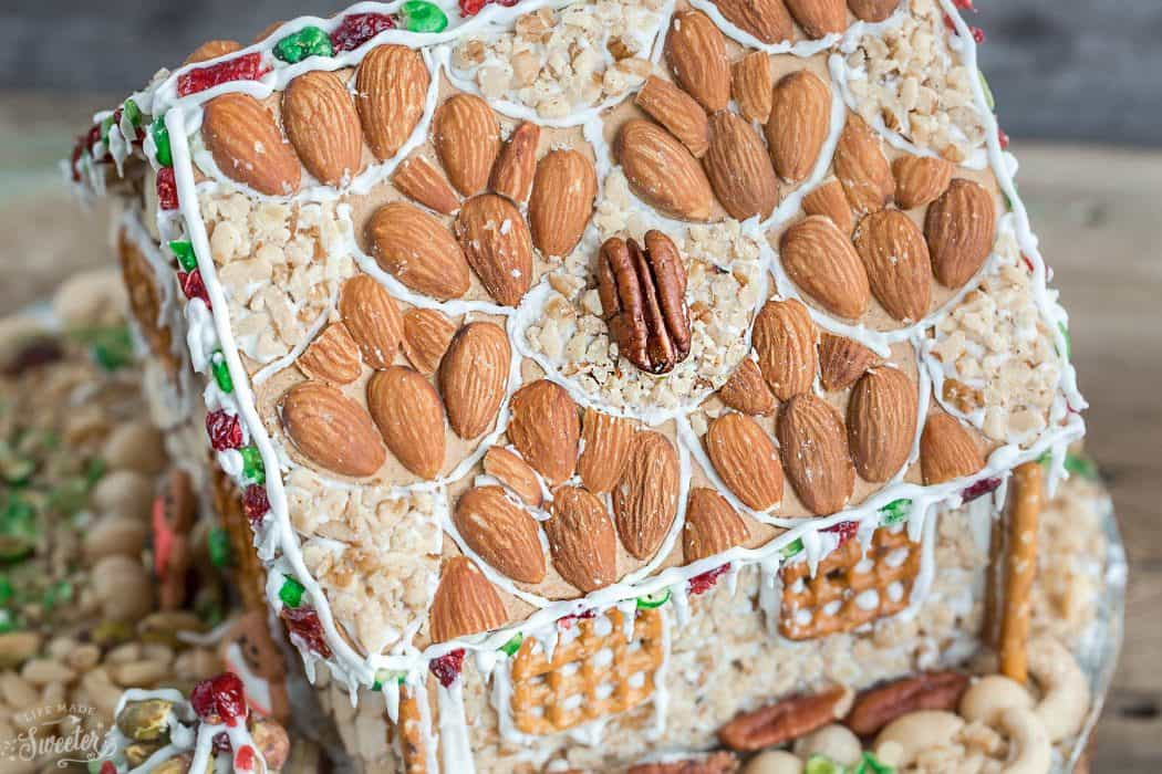 "An easy and simple way to make a ""gingerbread"" house using graham crackers and nuts. It's the perfect holiday activity for the kids and best of all, no baking required!"