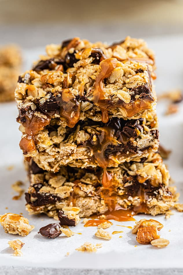 Healthy Oatmeal Bars stacked with caramel drizzle