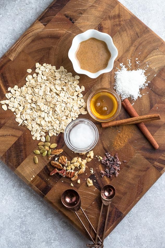 Ingredients to make oatmeal cookies on a cutting board