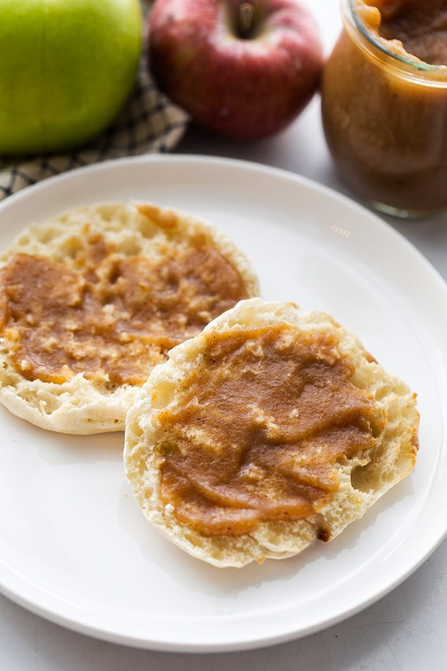 Crock Pot Apple Butter spread on two English Muffin halves on a plate