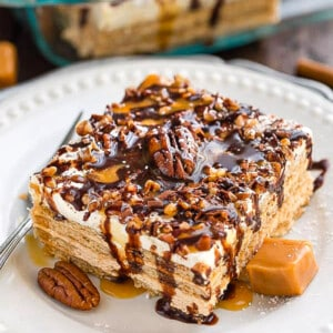Side view of a square of Peanut Butter Icebox Cake on a white plate