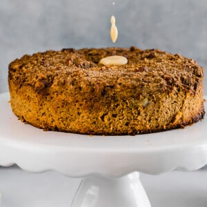 Side view of keto pumpkin cake with on a white cake stand